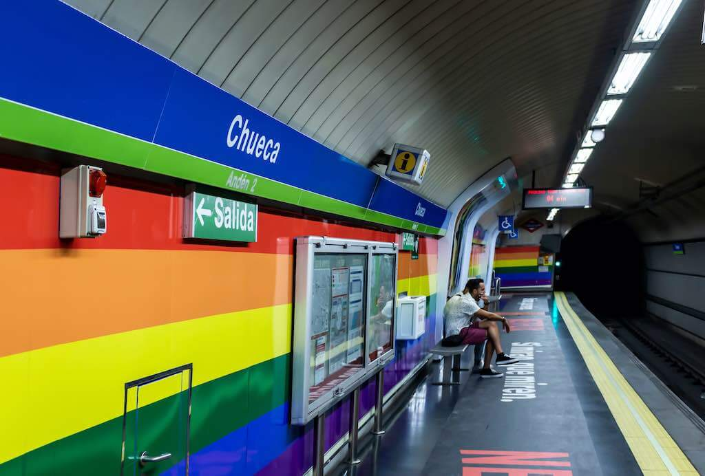 Chueca neighborhood in Madrid, decorated during gay pride day celebrations - by Victor Lafuente Alonso : Shutterstock.com