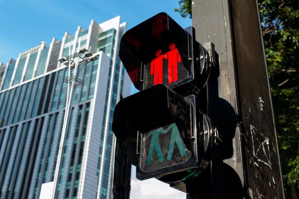 Crossing pedestrian lights on Pride week at Paulista Avenue located in Sao Paulo, Brazil - by Jo Galvao : Shutterstock.com