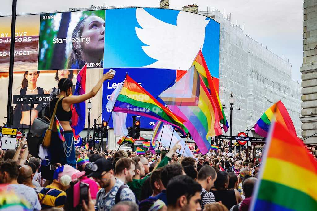 Piccadilly Circus in London full of people with flags celebrating London Gay Pride 2019 - Davi Barbiere : Shutterstock.com