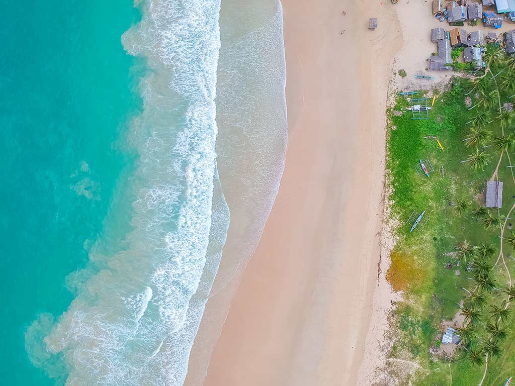 Nacpan Beach, El Nido - by Cris Tagupa / Unsplash.com