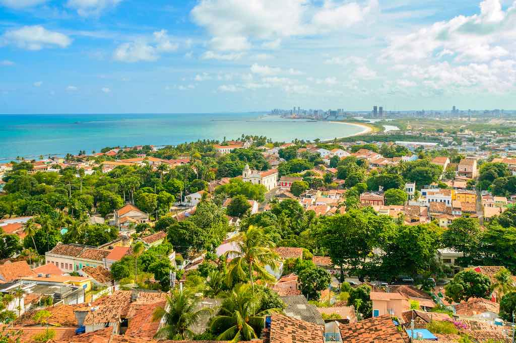 Brazilian old town of Olinda, aerial view with the city of Recife in the background - by By Thoom/shutterstock