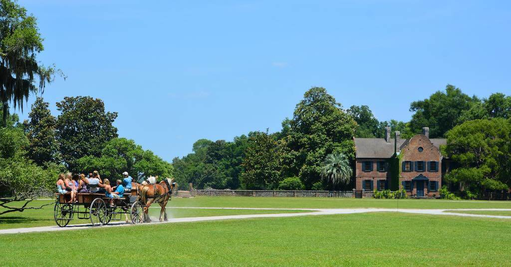 Horse-drawn carriages at Middleton Place, Charelston - by meunierd _ Shutterstock.com