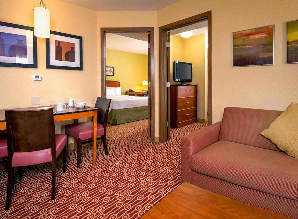 A suite at the pet friendly TownePlace Suites Virginia Beach hotel - by Booking.com