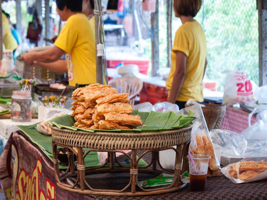 Crispy roti shop at Bang Nam Pheung floating market – by photosthai_Shutterstock.com