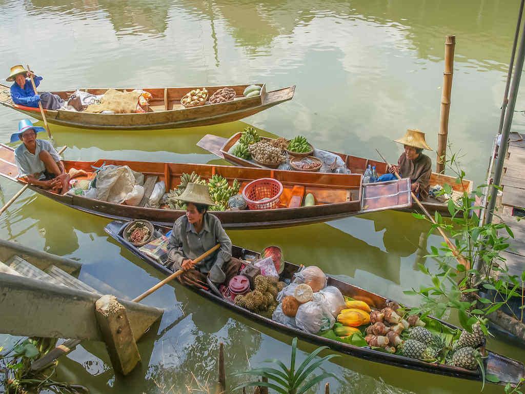 Fruit-seller at Bang Noi floating market - by Yuttana Joe_Shutterstock.com