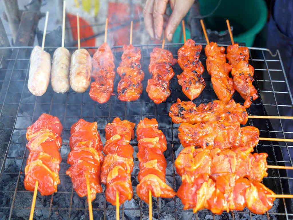 Grilled chicken at Bang Khla floating market - By Mr.Tawatchai Kemgumnerd_Shutterstock.com