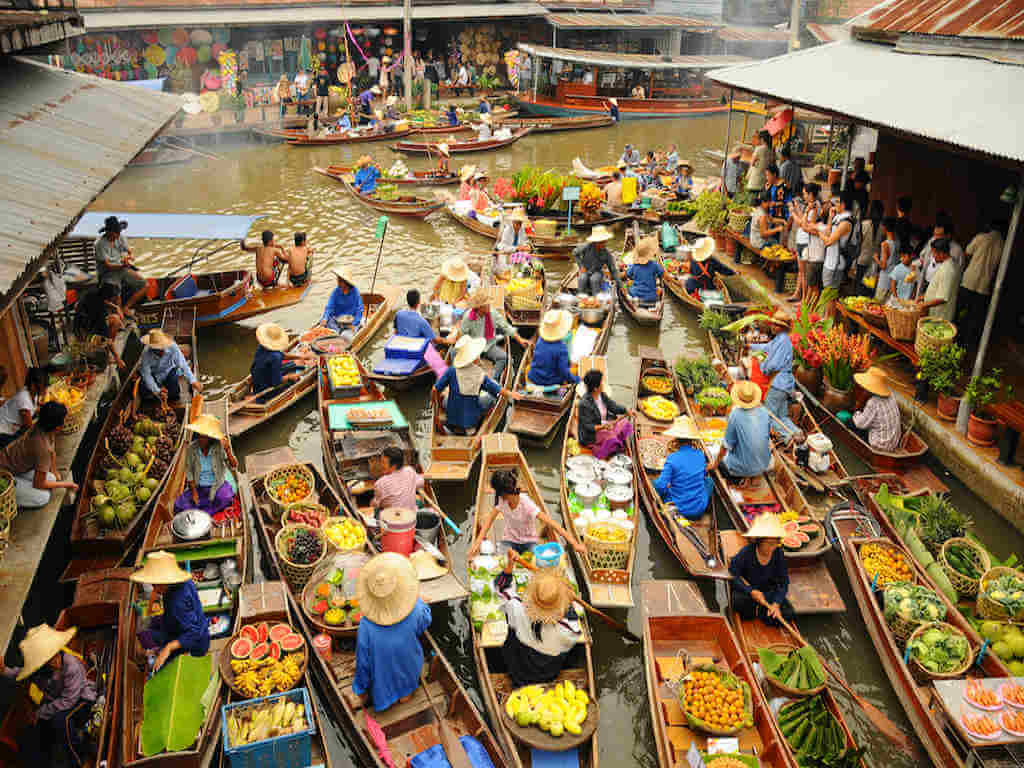 Wooden boats at Amphawa floating market – by nimon_Shutterstock.com
